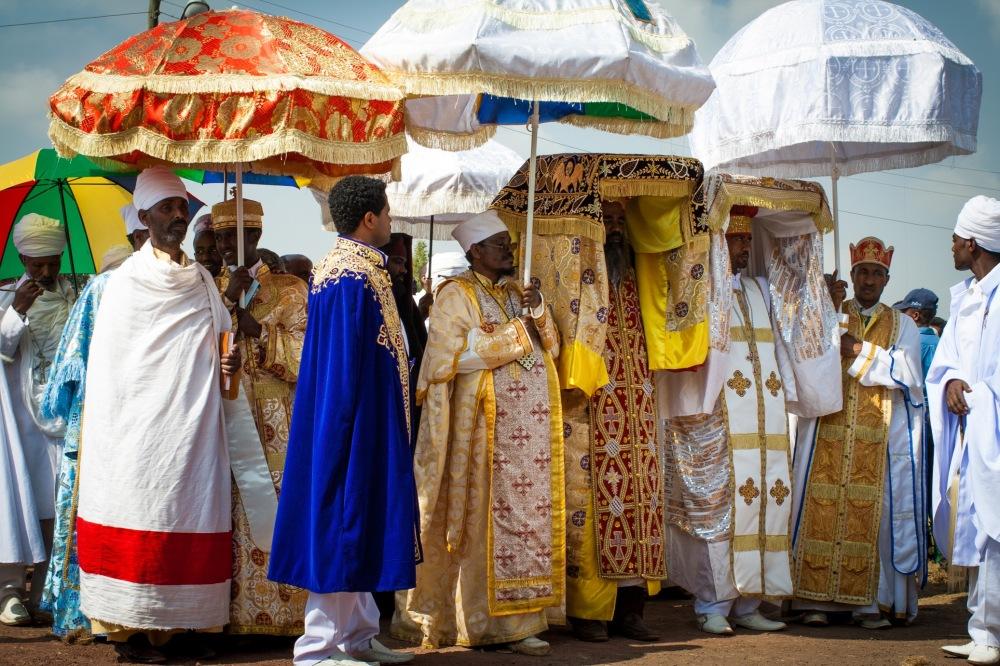Ethiopian Indiana Jones carrying replicas of the Ark.